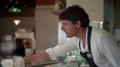 Waiter cleaning cafe counter. Stock Footage