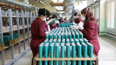 Workers checking RPG explosives in munition factory Stock Footage