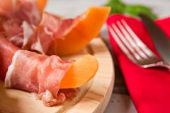 Close up of prosciutto and melon Italian appetizer - stock photo