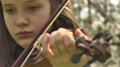 Girl Ending Play Violin in a Flowering Garden - stock footage