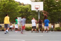 Motion Blur of Young Men Playing Playground Basketball Game Kuvituskuvat