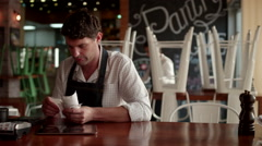 Waiter checking receipts at cafe. Stock Footage