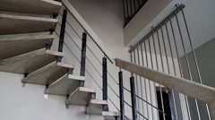 The interior of stylish contemporary house. The modern staircase. - stock footage