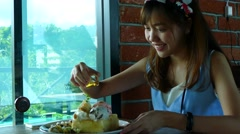 Young beautiful women eating honey toast in cafe coffee Stock Footage