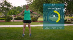 Slow Motion Woman Exercising Jumping Jacks in Park with Graphics Stock Footage