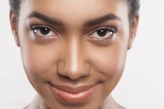 Beautiful african girl caring of her appearance - stock photo
