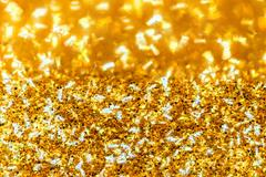 Abstract golden glitter background Stock Photos
