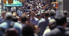 Crowd of commuter people walking on street in New York City anonymous face Stock Footage