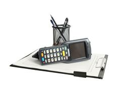 Business still life with barcode scanner, clerical clipboard and stationery.  - stock photo