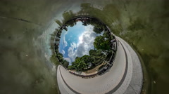 360Vr Video Walkers in the Green Park Embankment of Shallow Pond Limpid Water Stock Footage