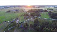 Beautiful summer sunset. Green fields and forest. Aerial footage. - stock footage