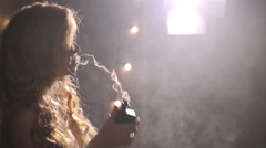 Woman smoke e cigarette, exhale thick flow, a lot of vapor fill whole frame Stock Footage