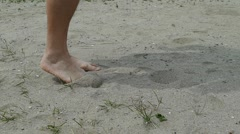 Hands legs walking on sand and kicking sand - stock footage