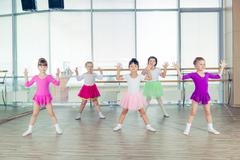Happy children dancing on in hall, healthy life, kid's togetherness and Stock Photos