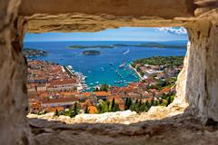Hvar bay aerial view through stone window Stock Photos