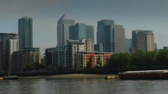 London's Canary Wharf seen from moving boat Stock Footage