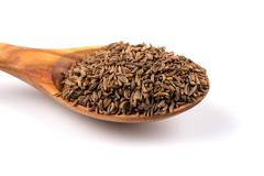 Caraway seeds in spoon - stock photo