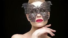 Beautiful Mature Woman Wearing Black Carnival Mask Stock Footage