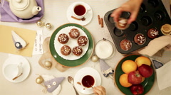 Abundant bunfight with homemade muffins and fruit in the family circle Stock Footage