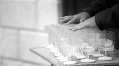 Black and white footage of a busker playing the wine glasses Stock Footage