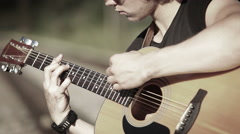 A close up portrait of a guitarist playing chords-based melody - stock footage