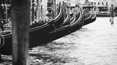 Black and white footage of Venetian gondolas rocking on waves Stock Footage