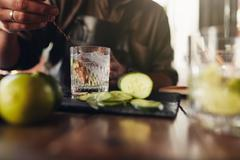 Bartender stirring a cocktail - stock photo