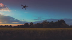 Custom drone hexacopter flying in the sky at sunset Stock Footage