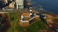 Aerial View of Farol da Barra Lighthouse in Salvador, Bahia, Brazil - Zoom Out Stock Footage