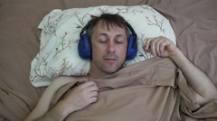 Man Sleeping in Daytime With Earmuffs Stock Footage