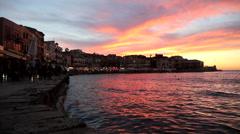 Greek tavernas with mediterrean sea at sunset Stock Footage