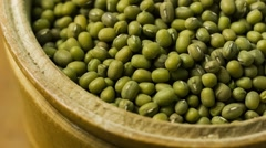 Mung bean in wooden bowl (BMCC 2.5K - 2400x1350) Stock Footage
