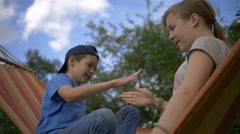 children playing rock-paper-scissors, girl win, slow motion - stock footage