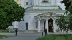 People Near Entrance to Five-Domed Cathedral Golden Cupolas Church Courtyard Stock Footage
