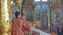 Young Priests Are Using an Incensory Service Trinity Day Kiev Ukraine Stock Footage