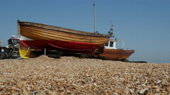 Fishing Boats beached onshore at Deal - stock footage