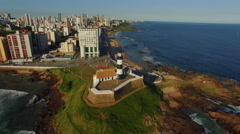 Aerial View of Farol da Barra Lighthouse and Salvador Cityscape, Bahia, Brazil Stock Footage
