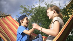 Boy with a girl playing rock-paper-scissors, boy win, slow motion Stock Footage