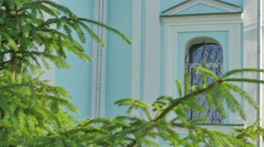 Church Courtyard Turquoise Walls Green Trees Branches Swaying at the Wind Stock Footage