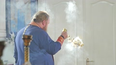 Orthodox Priest is Using an Incensory Trinity Day Service Church in Ukraine Stock Footage