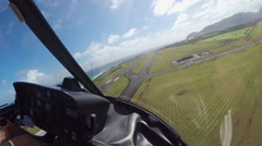 AERIAL: Flying above airfield and airplane runways at local airport in Hawaii - stock footage