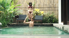 Young couple fighting, arguing by  the swimming pool Stock Footage