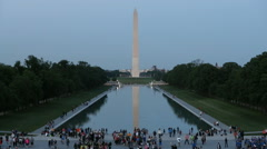Washington Monmuent & Reflection Pool Evening with Tourists Slow Motion - stock footage