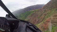 AERIAL: Copter flying pass the mountain cliffs and rocky walls in rainy Hawaii - stock footage