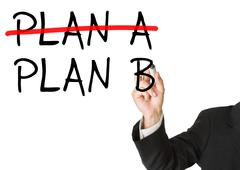 Plan B as alternative for plan a - man writing on whiteboard - stock photo