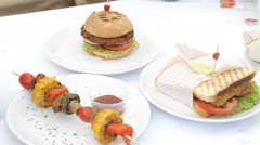 Homemade veggie burger served on wooden table. - stock footage