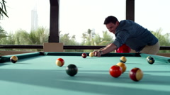 Father teaching his son billiards. - stock footage