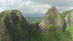 AERIAL: Flying between majestic mountain tops above lush rainforest jungle Stock Footage