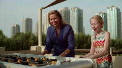 Mother and daughter playing foosball. - stock footage