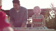 Father with children playing table football. Stock Footage